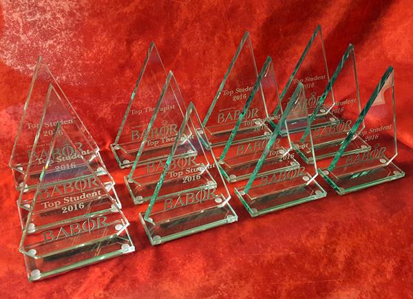 Polished glass triangle shaped trophies